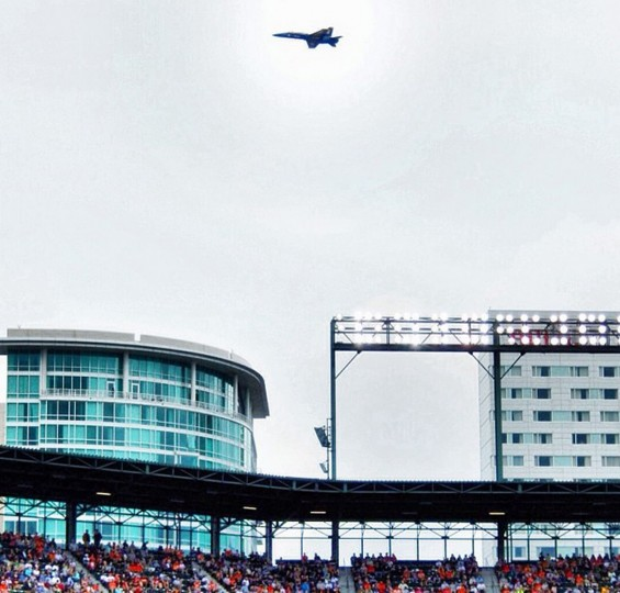 A U.S. Navy Blue Angels jet flies near Camden Yards during the Sept. 13, 2014 Orioles game against the Yankees.