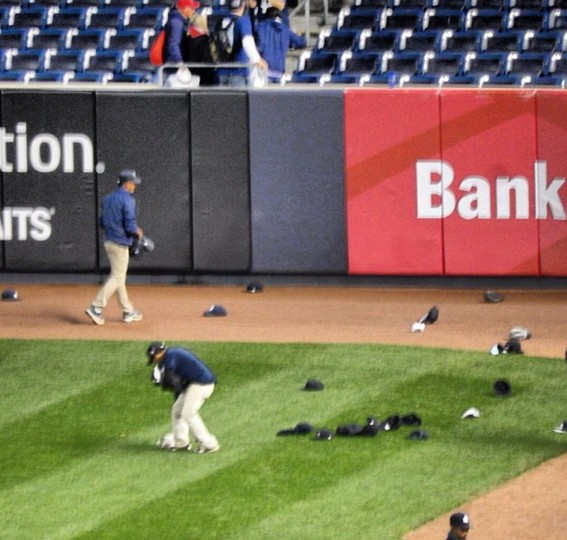 Fans saluted Derek Jeter after his last game at Yankee Stadium by throwing their Yankees caps onto the field, leaving lots to clean up.