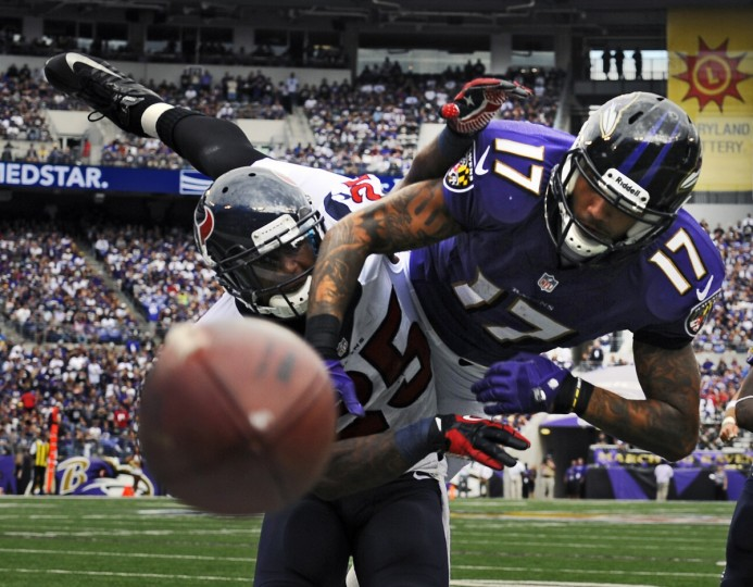 The Texans' Kareem Jackson, left, is called for defensive pass interference on Ravens wide receiver Tandon Doss in the third quarter. (Kenneth K. Lam/Baltimore Sun)