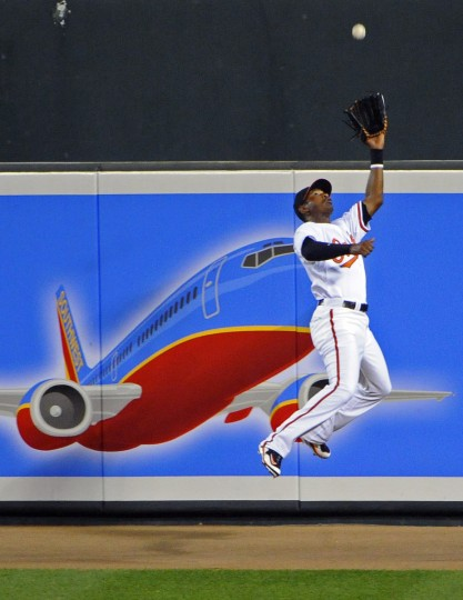 Adam Jones makes a leaping catch to retire Red Sox's Adrian Beltre in the fourth inning at Camden Yards in September 2010. (Kenneth K. Lam/Baltimore Sun)