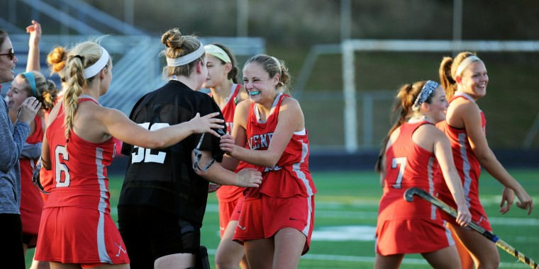 Glenelg players celebrate the victory over Marriotts Ridge in a sectional final playoff field hockey game at Marriotts Ridge High School in Marriottsville on Monday, Oct. 27, 2014. (Jon Sham/BSMG)