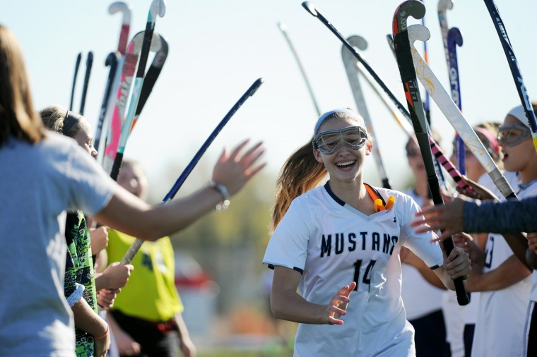 Marriotts Ridge's Sarah Blalock is introduced to the crowd before a sectional final playoff field hockey game at Marriotts Ridge High School in Marriottsville on Monday, Oct. 27, 2014. (Jon Sham/BSMG)