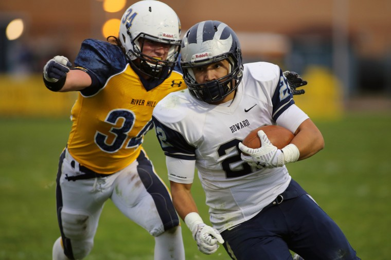 River Hill senior captain Brian Kirby (left) prepares to tackle Howard's Vale Vandon during a 7-0 loss to Howard at River Hill High School in Clarksville on Friday, Oct. 31. (James Levin/BSMG)