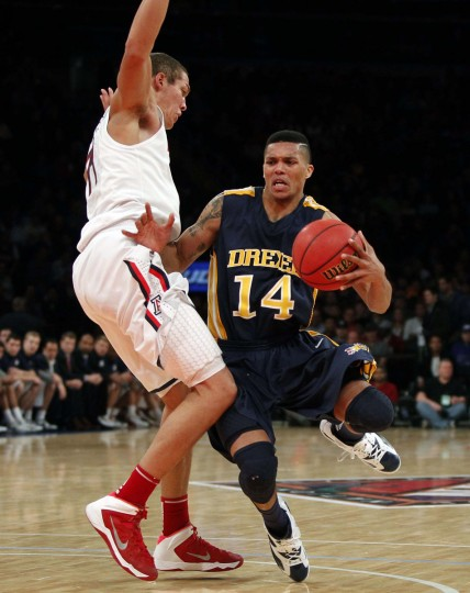 Name: Damion Lee College: Drexel Position: Guard Year: Redshirt junior High school: Calvert Hall Hometown: Baltimore 2013-14 stats: 13 points, 4.2 rebounds in five games. In his first game as a junior, Lee scored 22 points at UCLA, following up a sophomore season in which he averaged 17. The 2011-12 Colonial Athletic Association Rookie of the Year seemed well on his way to cementing his status as one of the top mid-major players in the country. But then he tore his ACL in the Dragons' fifth game, against Arizona, and was gone for the year. Now healthy after a redshirt year, Lee is a preseason first-team All-CAA pick and the No. 1 player for The Baltimore Sun's 2014-15 Sweet 16. (Noah K. Murray-USA TODAY Sports)