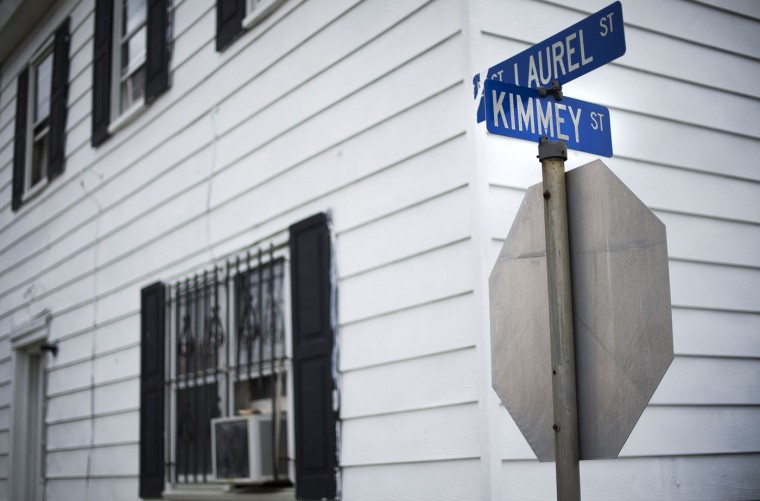 "A street sign for Kimmey Street rests November 7, 2014, atop a stop sign in what is locally known as ""Kimmeytown"", an area of Georgetown, Delaware on November 6, 2014. Georgetown is home to more than 2,500 Hispanic residents, which became a Guatemalan enclave beginning in the 1990's. (Jim Watson/AFP/Getty Images)"