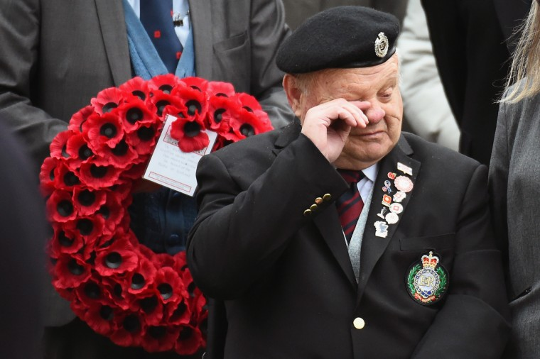 Former Royal Engineer Robert Mackenzie and Barbara Mackenzie from East Linton join Veterans and members of the public to pay tribute to those who died during the two World Wars and subsequent conflicts at the garden of remembrance on Armistice Day, on November 11, 2014 in Edinburgh, Scotland. A two minute silence was observed across the country at 11:00am, to honour those who fell during World War I and World War II , also recognising those who have died in conflicts since. (Jeff J Mitchell/Getty Images)