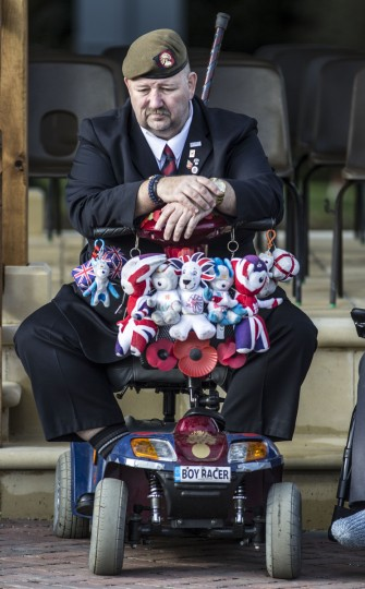 A veteran awaits the start of the Armistice day service at the Royal British Legion village which was attended by Defence secretary Michael Fallon on November 11, 2014 in Aylesford, Kent. (Richard Pohle/WPA Pool/Getty Images)