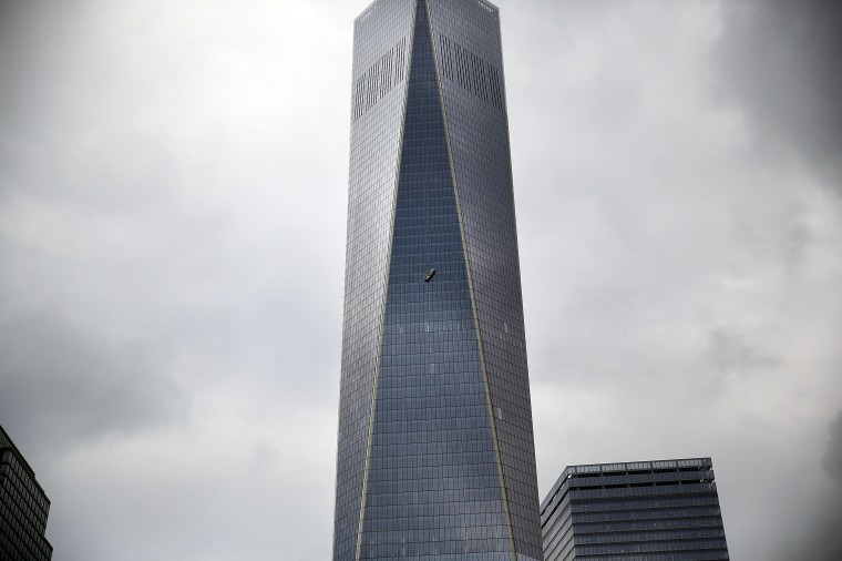 A scaffold carrying two workers hangs 69 floors up at One World Trade Center on November 12, 2014 in New York City. The workers were washing windows 69 floors up soon after One World Trade Center, the tallest building in the Western Hemisphere, opened. (Photo by Spencer Platt/Getty Images)