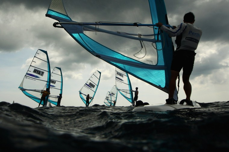 Competitors race in the Men's RS-One Windsurfing class during the 2014 Asian Beach Games at Karon Beach on November 16, 2014 in Phuket, Thailand. (Cameron Spencer/Getty Images)