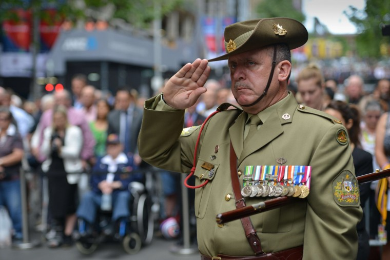 Australian Army Warrant Officer Stephen Chiesa observes a minutes silence at the Cenotaph national war memorial to pay tribute to the Commonwealth war dead on Armistice Day in Sydney on November 11, 2014. (Peter Parks/AFP/Getty Images)