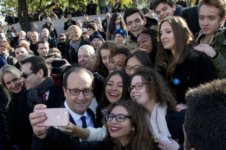 French President Francois Hollande makes selfies picture with onlookers after the ceremony at the Tomb of the Unknown soldier under the Arc de Triomphe on November 11, 2014 in Paris, as part of the Armistice Day ceremonies marking the 96th anniversary of the end of World War I. A(Francois Mori/AFP/Getty Images)