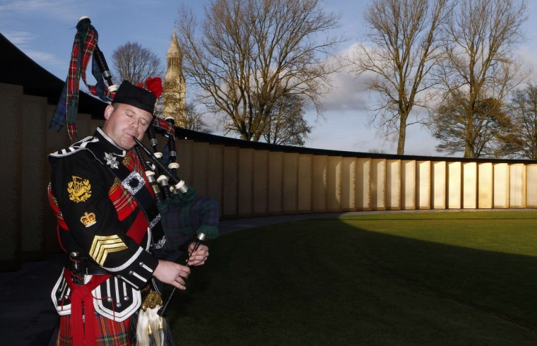 A bagpipe player performs during a ceremony at the Notre-Dame de Lorette war memorial on November 11, 2014 in Ablain-Saint-Nazaire, northern France, as part of the Armistice Day ceremonies marking the 96th anniversary of the end of World War I. (Michel Spingler/AFP/Getty Images)