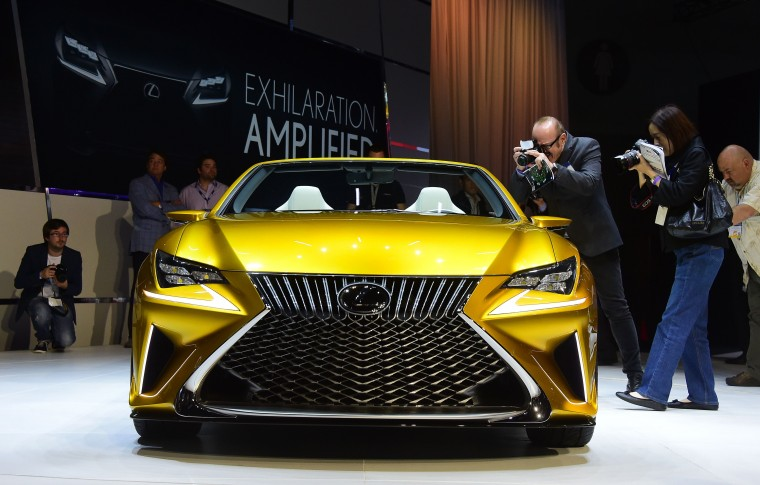 People step in to photograph the interior of the just unveiled Lexus LF-C2 concept vehicle on display at the LA Auto Show's press and trade day in Los Angeles, California on November 19, 2014. Nearly 60 North American and World vehicle debuts will be unveiled at this years auto show which opens to the public from November 21 to 30. (Frederic J. Brown/AFP/Getty Images)