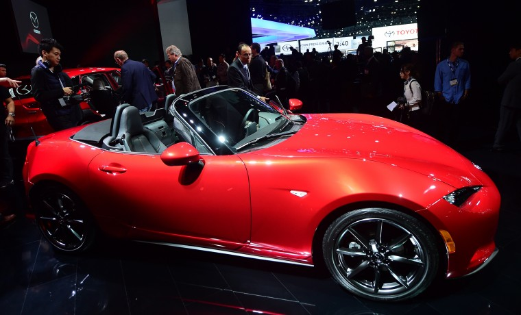 Mazda's new 2016 MX5 Convertible attracts attention while on display at the LA Auto Show's press and trade day in Los Angeles, California on November 19, 2014. Nearly 60 North American and World vehicle debuts will be unveiled at this years auto show which opens to the public from November 21 to 30. (Frederic J. Brown/AFP/Getty Images)