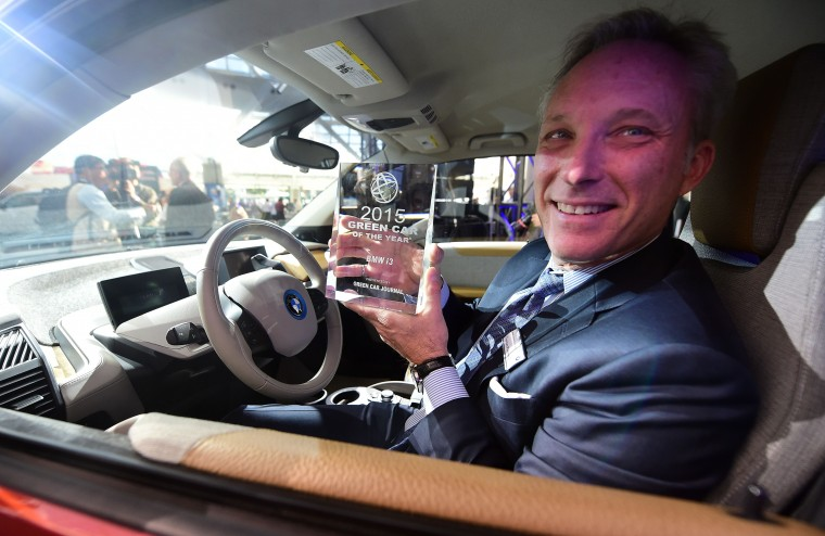 BMW's manager of Corporate Communications, Thomas Plucinsky, poses with the Green Car of the Year Award inside the Green Car of the Year, the BMW i3, on display at the LA Auto Show's press and trade day in Los Angeles, California on November 20, 2014. The LA Auto Show which opens to the public on November 21 and will run until November 30. (Frederic J. Brown/AFP/Getty Images)