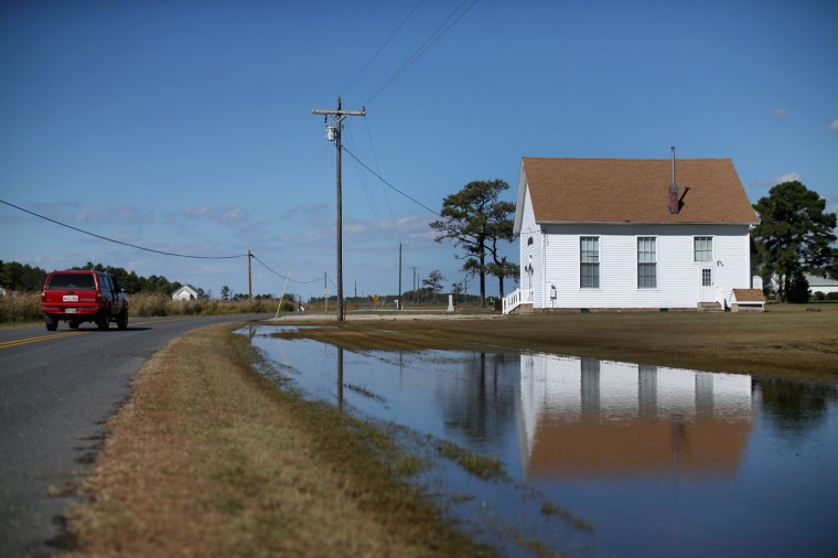 Water is pooled in front of a old church after a Chesapeake Bay high tide earlier in the week October 8, 2014 in Hoopers Island, Maryland. Several islands in the Chesapeake Bay region are slowly eroding away as sea levels are projected to rise several feet over the next century. (Photo by Mark Wilson/Getty Images)