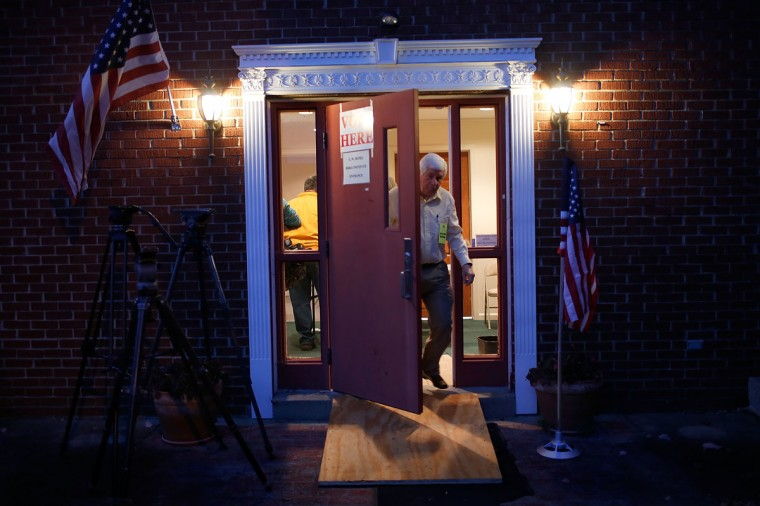 An election official opens the door at the polling station located at Pleasant Green Baptist Church November 4, 2014 in Lexington, Kentucky. The United States holds its midterm election today, with control of the U.S. Senate at stake in the vote. (Win McNamee/Getty Images)