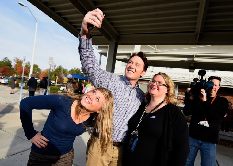 "Clay Aiken, Democratic candidate for U.S. Congress in North Carolina's Second District, poses for a selfie with supporters after casting his vote in the midterm elections on November 4, 2014 at Mills Park Elementary School in Cary, North Carolina. Aiken, a former ""American Idol"" contestant, is running for political office for the first time. (Grant Halverson/Getty Images)"