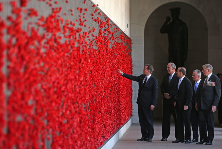 British Prime Minister David Cameron (L) walks along the Roll of Honor in the cloisters with the Australian Minister for Defense David Johnston (2nd L), Australian Prime Minister Tony Abbott, Brendan Nelson, Director of the Australian War Memorial (2nd R) and Memorial Chairman Rear Admiral Ken Doolan (R) at the Australian War Memorial on November 14, 2014 in Canberra, Australia. British Prime Minister David Cameron is attending meeting and events in Sydney and Canberra before traveling to the G20 Summit in Brisbane later today. (Rick Rycroft- Pool/Getty Images)