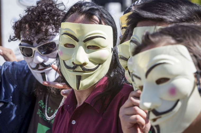 Anonymous activists meet in inner Brisbane wearing Guy Fawkes masks, an item that has been banned during the G20 Summit, ahead of the Peoples' March on November 14, 2014 in Brisbane, Australia. The Peoples' March is expected to be one of the largest protests during the summit. World leaders have gathered in Brisbane for the annual G20 Summit and are expected to discuss economic growth, free trade and climate change as well as pressing issues including the situation in Ukraine and the Ebola crisis. (Glenn Hunt/Getty Images)