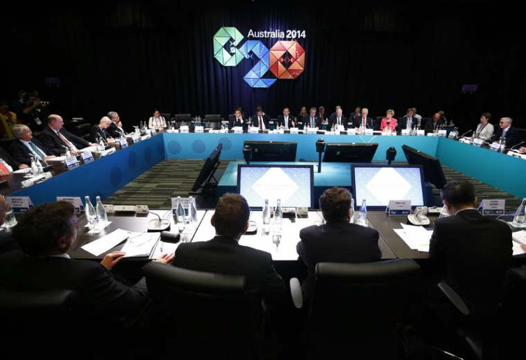 Australian Prime Minister Tony Abbott (Rear, C) addresses the B20 meeting ahead of the G20 leaders summit on November 14, 2014 in Brisbane Australia. World leaders have gathered in Brisbane for the annual G20 Summit and are expected to discuss economic growth, free trade and climate change as well as pressing issues including the situation in Ukraine and the Ebola crisis. (Jason Reed-Pool/Getty Images)