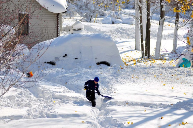 Drew Ahmed makes his way through nearly five feet of snow on November 19, 2014 in the Lakeview neighborhood of Buffalo, New York. The record setting Lake effect snowstorm dumped up to six feet of snow in less than 24 hours closing a one hundred mile section of The New York State Thruway as well as other major roads around Buffalo. Four deaths have already been attributed to the storm and a second round beginning late Wednesday evening will bring up to three more feet of snow overnight. (John Normile/Getty Images)