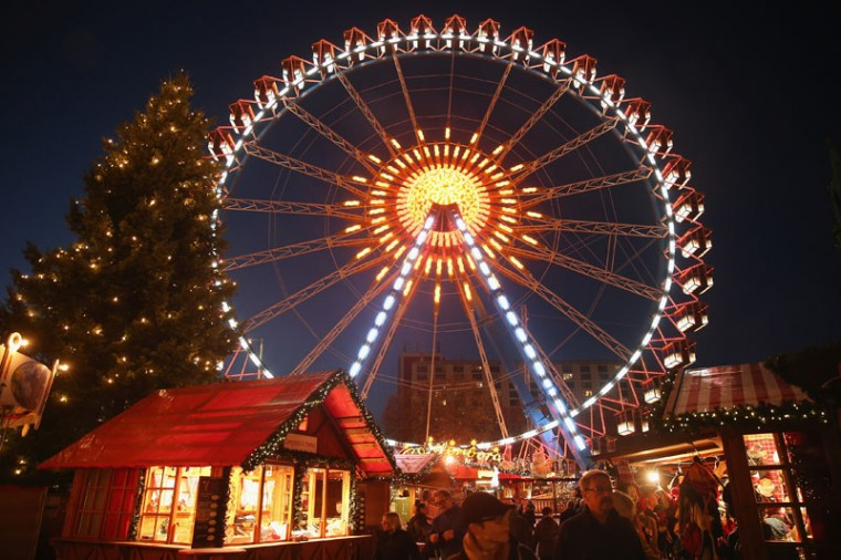 An illuminated ferris wheel spins at the Christmas market at Alexanderplatz on its opening day on November 24, 2014 in Berlin, Germany. Christmas markets across Germany will open across Germany this week and stay open through the end of December to sell Gluehwein, Christmas decorations, sweets and other delights. (Sean Gallup/Getty Images)
