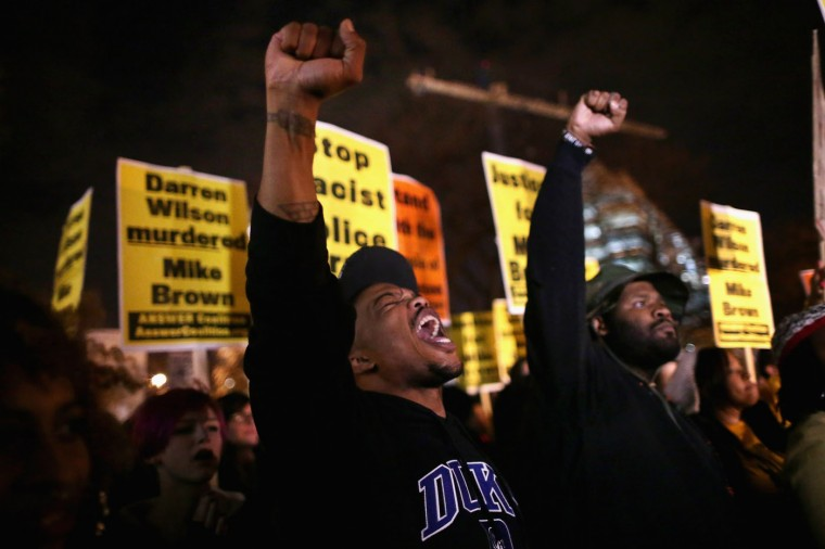 Hundreds of demonstrators gather to protest the day after the Ferguson grand jury decision to not indict officer Darren Wilson in the Michael Brown case November 25, 2014 in Washington, DC. A St. Louis County grand jury decided to not indict Ferguson police Officer Darren Wilson in the shooting death of Michael Brown in August that sparked riots in Ferguson, Missouri, resulting in violence there Monday night. (Photo by Chip Somodevilla/Getty Images)