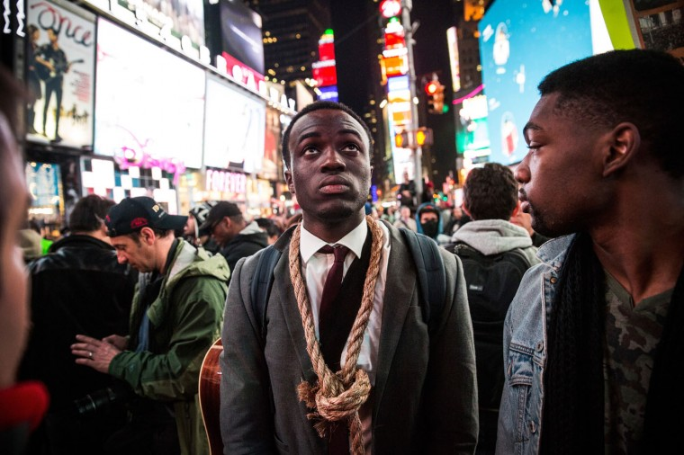 People protest in Times Square over the Ferguson grand jury decision to not indict officer Darren Wilson in the Michael Brown case November 25, 2014 in New York City. Brown, an 18-year-old black man, was killed by Darren Wilson, a white Ferguson, MO police officer, on August 9. Violent protests erupted across the nation yesterday after the grand jury's verdict was announced, most notably in Ferguson, MO, where more than 25 buildings were burned down and stores were looted. (Photo by Andrew Burton/Getty Images)