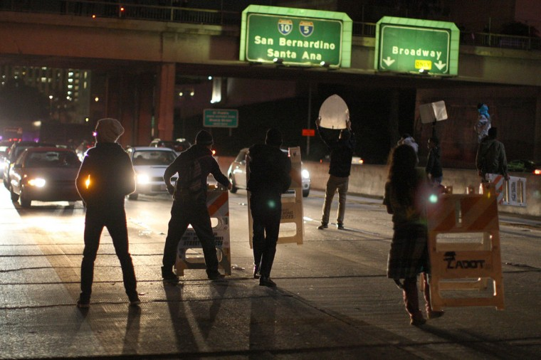 Protesters set up barricades and shut down the 101 freeway following the grand jury decision not to indict a white police officer who had shot dead an unarmed black teenager in Ferguson, Missouri on the night of November 25, 2014 in Los Angeles, California. Police officer Darren Wilson shot 18-year-old Michael Brown on August 9, sparking large ongoing protests. (Photo by David McNew/Getty Images)