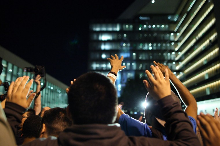 Protesters raise their hands durng a demonstration near Los Angles Police Departmet (LAPD) headquarters following the grand jury decision not to indict a white police officer who had shot dead an unarmed black teenager in Ferguson, Missouri on the night of November 25, 2014 in Los Angeles, California. Police officer Darren Wilson shot 18-year-old Michael Brown on August 9, sparking large ongoing protests. (Photo by David McNew/Getty Images)