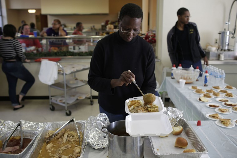 Jackie Mims prepares a Thanksgiving lunch at Wellspring Church November 27, 2014 in Ferguson, Missouri. Tension still run high in the Ferguson community after Michael Brown, a 18-year-old black male teenager was fatally wounded by Darren Wilson, a white Ferguson Police officer on August 9, 2014. A St. Louis County 12-member grand jury who reviewed evidence related to the shooting decided Monday not to indict Wilson with charges sparking riots through out Ferguson. (Photo by Joshua Lott/Getty Images)