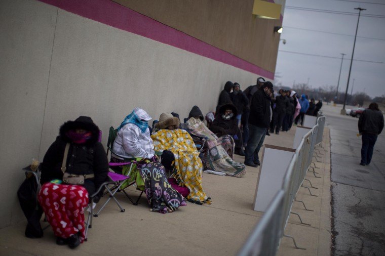 Shoppers wait in line for early Black Friday deals Thanksgiving evening at a Best Buy on November 27, 2014 in Indianapolis, Indiana. Many retailers open the evening before the famous shopping day. (Photo by Aaron P. Bernstein/Getty Images)