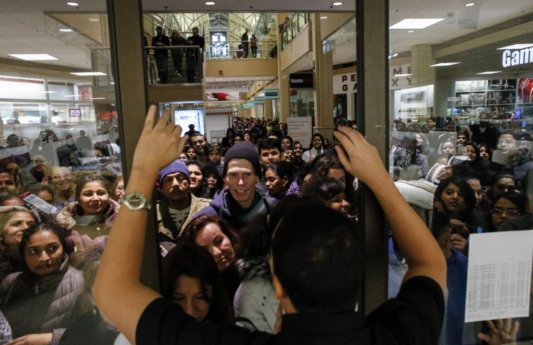 People waits in line to go shopping at the to JCPenney store at the Newport Mall on November 27, 2014 in Jersey City, New Jersey. Black Friday sales, which now begin on the Thursday of Thanksgiving, continue to draw shoppers out for deals and sales. (Photo by Kena Betancur/Getty Images)