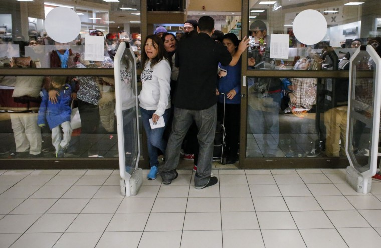 People enter to JCPenney store at the Newport Mall on November 27, 2014 in Jersey City, New Jersey. Black Friday sales, which now begin on the Thursday of Thanksgiving, continue to draw shoppers out for deals and sales. (Photo by Kena Betancur/Getty Images)