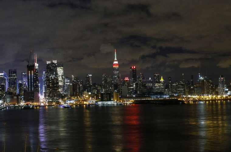 The Empire State Building is lit in Thanksgiving colors on November 27, 2014 from Weehawken, New Jersey. Black Friday sales, which now begin on the Thursday of Thanksgiving, continue to draw shoppers out for deals and sales. (Photo by Kena Betancur/Getty Images)