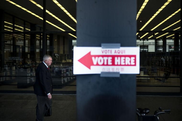 A man passes a polling place at the Martin Luther King Library on November 4, 2014 in Washington, DC. Voters around the United States went to the poles to vote in the 2014 interim election. (Brendan Smialowski/AFP/Getty Images)
