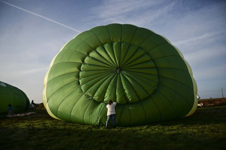 A hot air balloon enthusiast prepares a balloon during the 18th International Festival of Hot Air Balloons in Alter do Chao in the center of Portugal on November 10 2014. (Patricia De Melo Moreira/AFP/Getty Images)