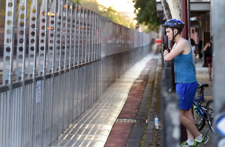 A cyclist looks at a giant security fence surrounding the Southbank precinct where the G20 Summit will be held in Brisbane on November 14, 2014. Australia hosts the leaders of the world's 20 biggest economies for the G20 summit in Brisbane on November 15 and 16. (William West/AFP/Getty Images)