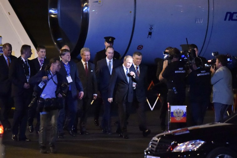 Russia's President Vladimir Putin (C) arrives at the airport in Brisbane to take part in the G20 summit on November 14, 2014. Australia hosts the leaders of the world's 20 biggest economies for the G20 summit in Brisbane on November 15 and 16. (Peter Parks/AFP/Getty Images)