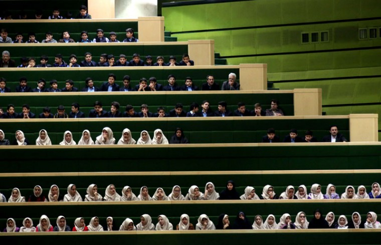 Iranian school girls attend a parliament session in Tehran on November 18, 2014, to listen to President Hassan Rouhani's speech defending his nominee for the ministry of Science, Research and Technology, Fakhredin Ahmadi Danesh Ashtiyani. Iran's parliament is expected to decide on the nomination of the new science minister following disagreements between the conservative-dominated body and reformist President Rouhani on the sensitive post. (Atta Kenare/AFP/Getty Images)