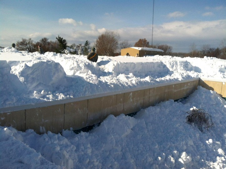 This US National Guard handout photo taken November 19, 2014 shows massive ammounts of snow on the roof of the roof of the Eden Heights Assisted Living Facility in West Seneca, New York, where members of the New York Air National Guard from the 107th Airlift Wing based in Niagara Falls, New York are assisting in snow removal efforts. The facility, like much of Western New York in Erie County, experienced historic levels of lake effect snowfall that paralyzed the City of Buffalo and area roads, businesses and communities. New York Governor Andrew Cuomo directed the mobilization of more than 240 National Guard Soldiers and Airmen from area units to assist local authorities with snow removal or traffic control as regions of Western New York see more than six feet (1.8m) of snowfall in just 72 hours. (Senior Master Sgt. Ray Lloyd/National Guard/AFP/Getty Images)