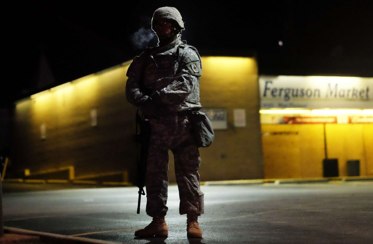 A National Guard trooper keeps vigil around local business in Ferguson, Missouri, on November 25, 2014 during demonstrations a day after violent protests and looting following the grand jury decision in the fatal shooting of a 18-year-old black teenager Michael Brown. Protest marches sprang up in cities across the US on November 25, amid a tense security operation in Ferguson, the Missouri town at the center of the country's latest racially-charged stand-off. Clashes erupted in the St Louis suburb for a second night, after grand jury's decision not to prosecute a white police officer for shooting dead an unarmed black teenager. Jewel Samad/AFP/Getty Images
