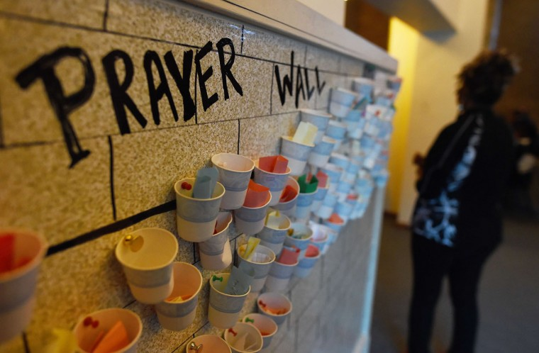 "A ""prayer wall"" is pictured at a church during a Thanksgiving service in Ferguson, Missouri, on November 27, 2014. Ferguson, a suburb of St Louis, has seen violent protests since the explosive decision by a Missouri grand jury not to charge a police Officer Darren Wilson, who shot dead 18-year-old Michael Brown on August 9. The decision revived long-standing questions about the treatment of young African Americans by police -- questions again asked after the weekend shooting in Cleveland of 12-year-old Tamir Rice. (Jewel SamadJ/AFP/Getty Images)"