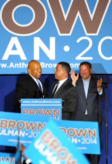 From left: Rep. Elijah Cummings; Lt. Gov. Anthony Brown and Ken Ullman greet each other at the War Memorial on the day before the gubernatorial election. Brown and Ulman are the democratic runners. (Algerina Perna, Baltimore Sun)