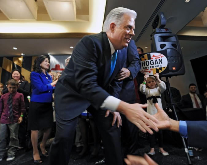 Maryland Governor-elect Larry Hogan, a Republican, shakes hand with supporters after his victory speech at his campaign headquarters on election night. (Kenneth K. Lam/Baltimore Sun)