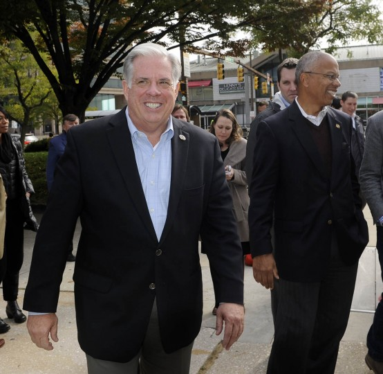 Republican gubernatorial candidate Larry Hogan, left, and his running mate Boyd Rutherford, right, smile as they leave a press conference they held near the Inner Harbor this afternoon. (Barbara Haddock Taylor, Baltimore Sun)
