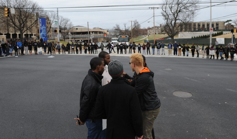 Protest organizers discuss their next move as students from Morgan State University hold the intersection of Perring Parkway and Cold Spring. The students were protesting a Missouri grand jury's decision not to indict police officer Darren Wilson in the shooting death of Michael Brown. (Jerry Jackson/Baltimore Sun)