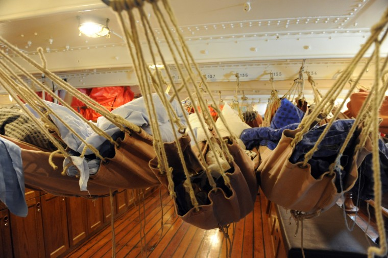 Accomodations for the 65 cadets aboard the HNoMS Statsraad Lehmkuhl, a training vessel for the Norwegian Navy. They sleep in hammocks suspended by hemp ropes aboard the 100 year old 3-masted barque. This is the oldest and largest square rigged sailing vessel in Norway. Kim Hairston/Baltimore Sun