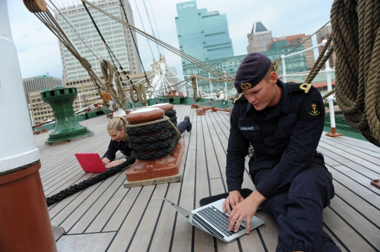 Left to right, Ingvild Ostbye and Jostein Kjernaas, both 21-year-old cadets from Oslo, Norway, make contact with family members after three weeks at sea. They are on the forecastle of the HNoMS Statsraad Lehmkuhl, a training vessel for the Norwegian Navy. Kim Hairston/Baltimore Sun